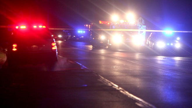 Police investigate the scene of a fatal accident that occurred just before midnight Sunday in Springfield Township.