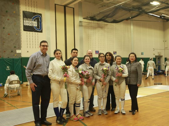 The Millburn female senior fencers with family members. Front: (left to right): Nicole Jurist, Tiffany Lin, Rachel Freundlich, Syedda Qudsiya and Jia-Ming Tuan.