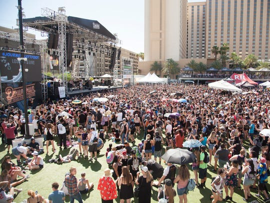 Music fans gather in front of the main stages at the