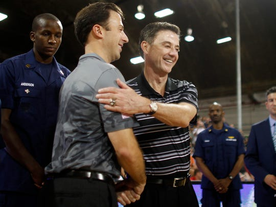 Minnesota coach Richard Pitino (left) greets father Rick Pitino during a 2014 game.
