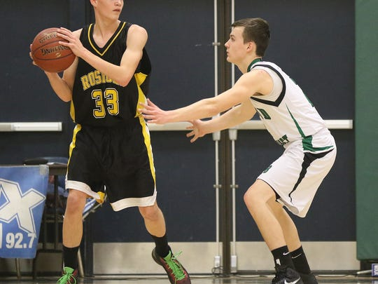 Rosholt's Cade Bowker, left, looks to pass against Almond-Bancroft's Wyatt Richtmyre during a Central Wisconsin Conference basketball game at Almond-Bancroft High School, Friday, Jan. 29, 2016.