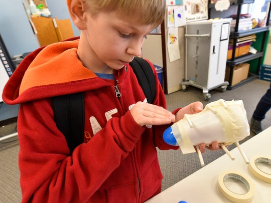 Gabriel Hurley works on his Crew Exploration Vehicle (CEV) at the Boys & Girls Club of Door County Wednesday, April 5, 2017.