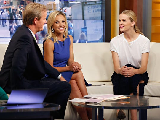 """Steve Doocy and Elisabeth Hasselbeck interview actress Brooklyn Decker during her visit to """"Fox & Friends"""" on Sept. 3, 2014, in New York City."""