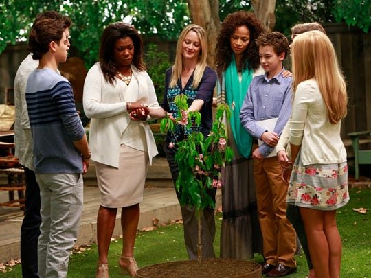 """This photo released by ABC Family shows, from left, Jake T. Austin, Lorraine Toussaint, Teri Polo, Sherri Saum, Hayden Byerly, and Maia Mitchell, in a scene from """"The Fosters,"""" on ABC Family. The media advocacy group GLAAD on Wednesday, Oct. 1, 2014, released its annual report on diversity on TV, including depictions of gay characters."""