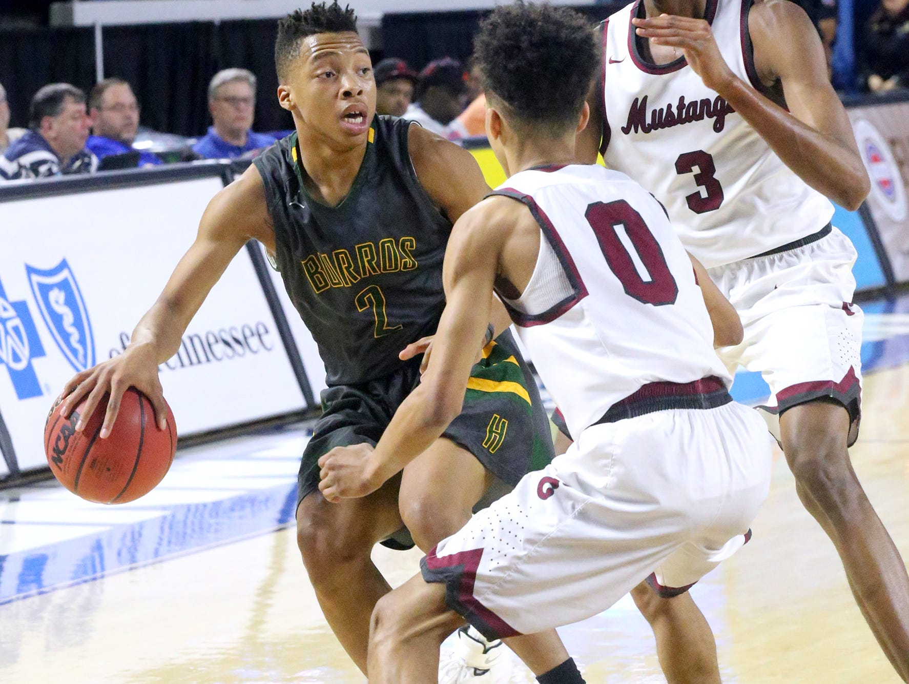 Hillsboro's Ronald Reeves (2) tries to look for an oper player as he is surrouned by Memphis East's Nikcolauz Merriweather (0) and Chandler Lawson (3) during the State Tournament Quarterfinal game, on Wednesday at MTSU.