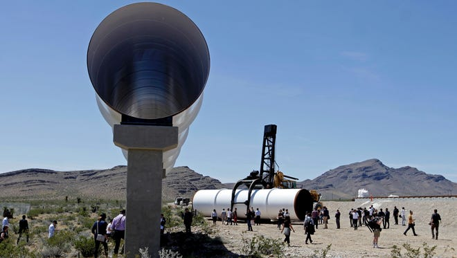 Hyperloop tubes are displayed during the first test of the propulsion system at the Hyperloop One Test and Safety site on May 11, 2016 in Las Vegas, Nevada. Hyperloop One stages the first public demonstration of a key component of the startup's futuristic rail transit concept that could one day ferry passengers at near supersonic speeds.