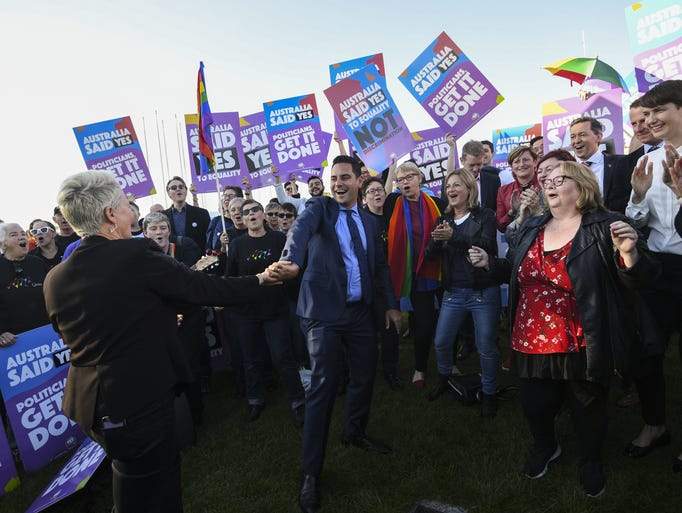 Same-sex marriage campaigner Alex Greenwich, center,