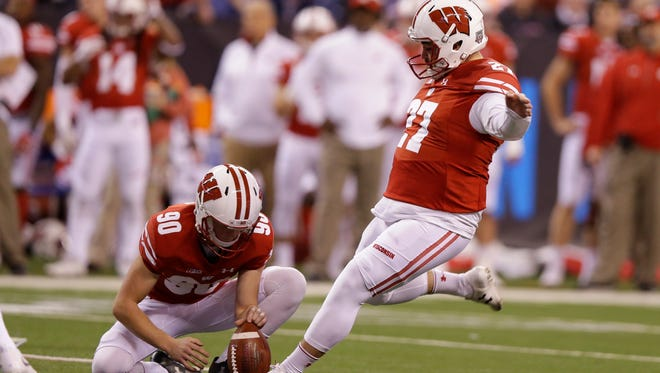 Wisconsin's Connor Allen (90) holds for place kicker Rafael Gaglianone (27) as he kicks a 28-yard field goal during the first half of the Big Ten championship game against Ohio State, Saturday, Dec. 2, 2017, in Indianapolis.