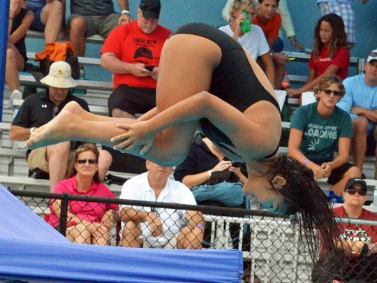 Dunbar sophomore Kayla Cotter spins through the air during the FHSAA Class 2A girls diving state finals on Friday (Nov. 3, 2017) at Sailfish Splashpark Aquatic Center in Stuart. Cotter finished 16th with 291.30 score.