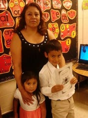 Alejandra Sanchez-Ponce with her son and daughter