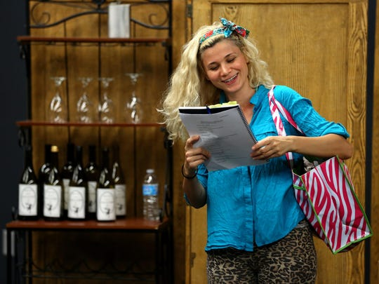 """Julia Brezeanu is seen during a rehearsal of Theatre 33's """"Successful Strategies, or How to Make Love Stay,"""" which is about Oregon winemaking. The playwright will discuss the script with the audience after the 2 p.m. performance Aug. 16 at Willamette University."""