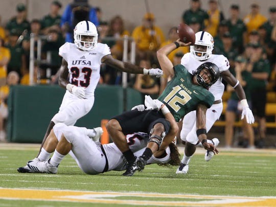 Baylor quarterback Anu Solomon (12) is pulled down by UTSA linebacker Josiah Tauaefa (55) on fourth down during Baylor's final possession in an NCAA college football game, Saturday, Sept. 9, 2017, in Waco, Texas. UTSA won 17-10. (Rod Aydelotte/Waco Tribune Herald, via AP)