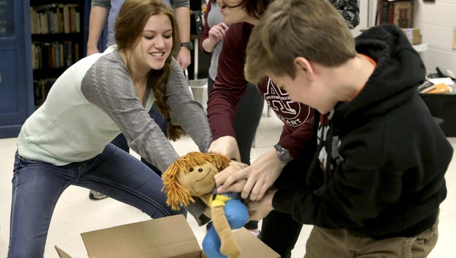 "Alyssa Jansen, playing Imogene Herdman, Leah Dreyer, playing Mother, and Aidan Buechler, playing Ralph Herdman, fight over a doll that is a stand in for the baby while rehearsing a scene for ""The Best Christmas Pageant Ever"" during a theater seminar production class at Appleton North High School earlier this month."