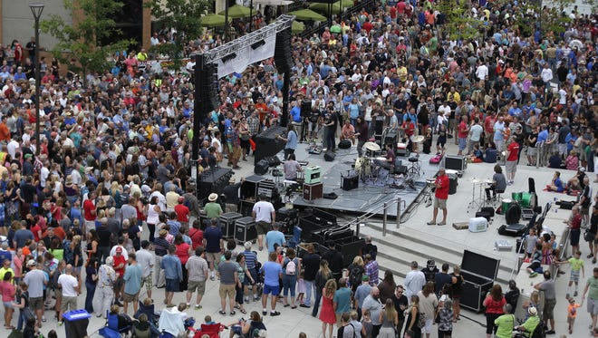 Roadkill Ghost Choir plays in front of a large crowd at Houdini Plaza during Mile of Music in August 2015.