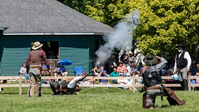 "Johnny Baker, aka ""The Cowboy Kid,"" preforms a trick shot at Buffalo Bill's Wild West Show at the Manitowoc County Historical Society's Pinecrest Historical Village Saturday, Aug. 12, 2017, in Manitowoc, Wis. Josh Clark/USA TODAY NETWORK-Wisconsin"