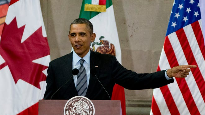 President Obama speaks during a news conference at the end of the North American Leaders Summit in Toluca, Mexico, on Feb. 19, 2014.