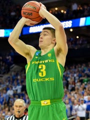 Oregon Ducks guard Payton Pritchard (3) shoots during the first half against the Kansas Jayhawks in the finals of the Midwest Regional of the 2017 NCAA Tournament at Sprint Center.