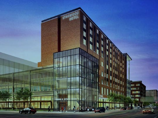 The hotel, shown above in an artist's rendering of a new parking garage, will likely not be included in the project to redevelop a city-owned parking garage at Seventh Street and Grand Avenue. City leaders said the hotel is proving too costly.
