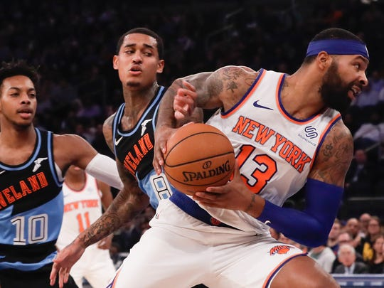 New York Knicks' Marcus Morris Sr. (13) spins away from Cleveland Cavaliers' Jordan Clarkson (8) and Darius Garland (10) during the first half of an NBA basketball game Monday, Nov. 18, 2019, in New York. (AP Photo/Frank Franklin II)