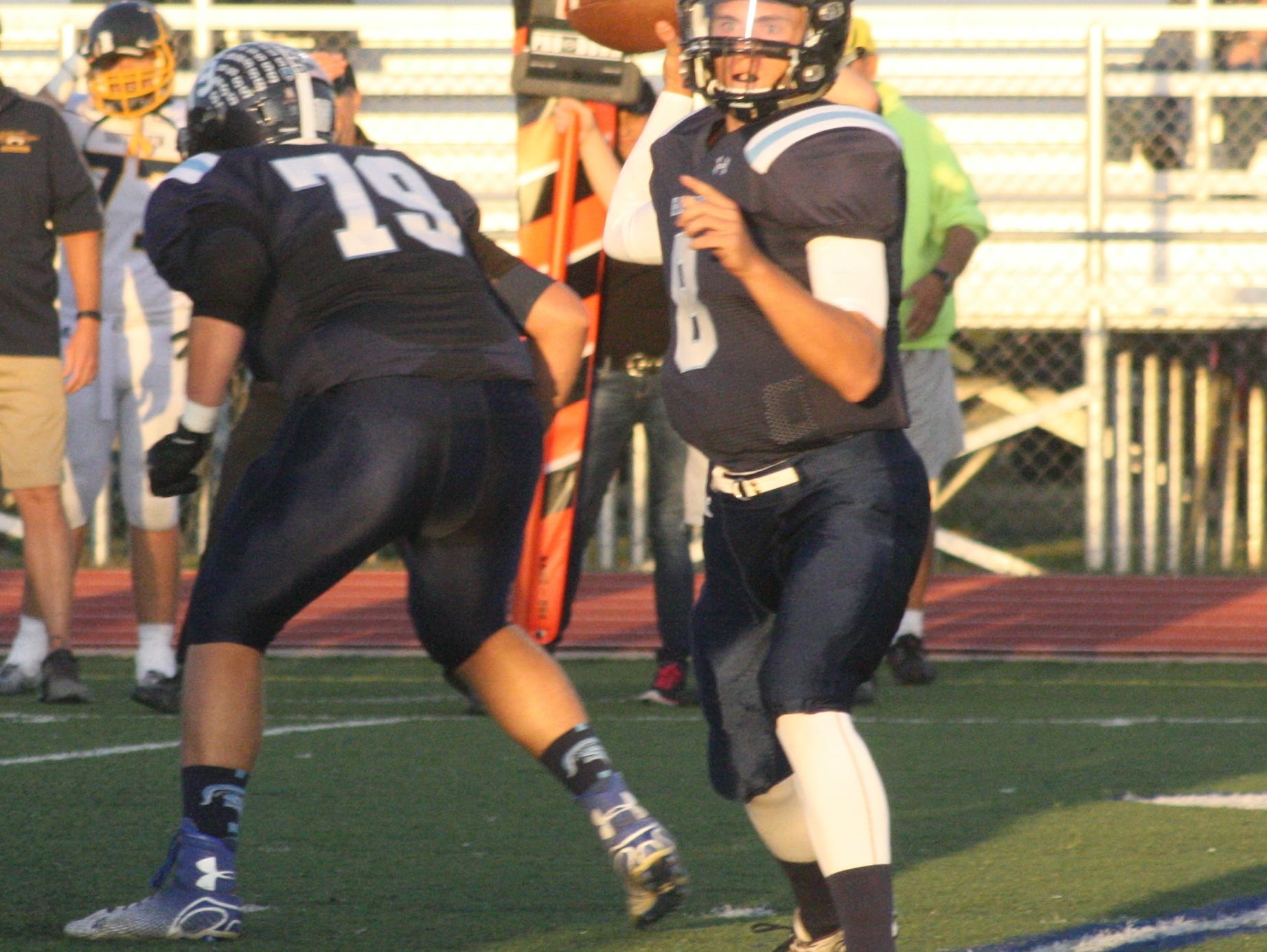 Chris Tanderys prepares to deliver his first pass of the night Friday against South Lyon.