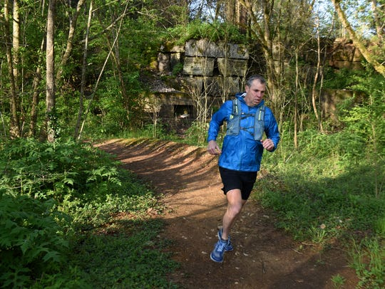 Brian Winter running on a trail at Ijams in South Knoxville Tuesday, April 17, 2018. Winter, a Knoxville resident, completed the international marathon challenge running seven marathons on seven continents in seven days.