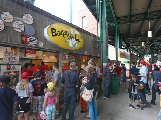 Hungry fans crowd in for their orders at Batter Up! between innings at Frontier Field during the Rochester Red Wings baseball game against Pawtucket Monday, June 29, 2015.