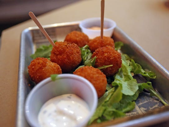 Fried risotto cheese balls at Holy Crab in White Plains.