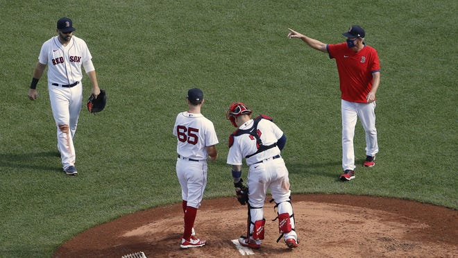 Mound visits from Ron Roenicke have been a familiar site during Red Sox games in 2020.