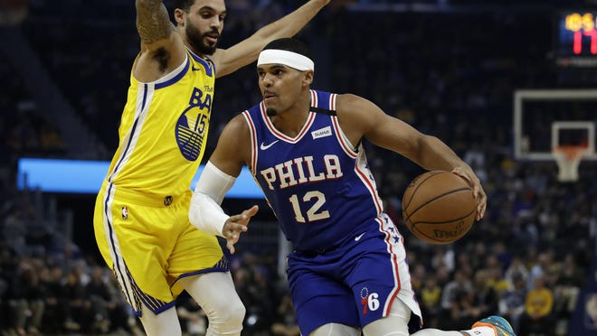 Philadelphia 76ers' Tobias Harris (12) drives the ball against Golden State Warriors' Michael Mulder, left, on March 7, 2020. Harris and teammate Matisse Thybulle marched with protesters through Philly on Saturday.