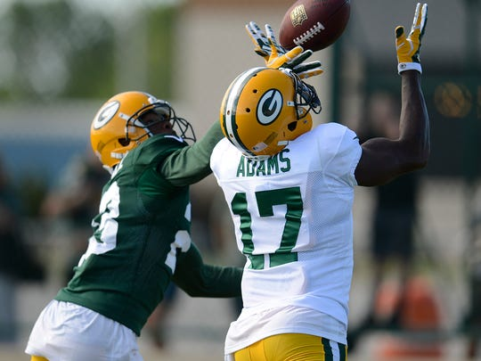 Green Bay Packers cornerback Damarious Randall (23) tries to break up a pass intended for receiver Davante Adams (17) during training camp practice at Ray Nitschke Field on Tuesday, Aug. 4, 2015. Adams made the catch on the play.