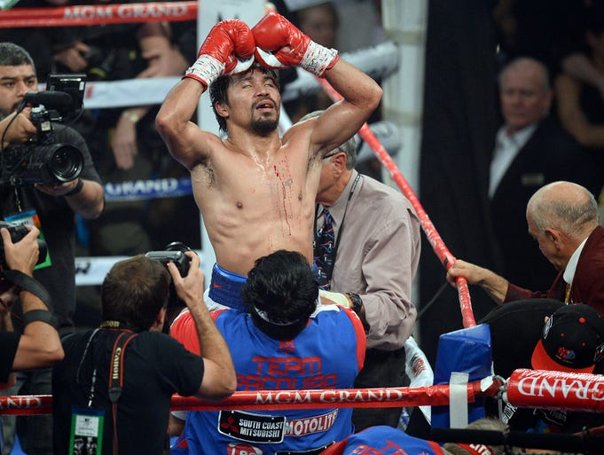 Manny Pacquiao celebrates his victory over Timothy Bradley after their WBO World Welterweight Title bout at MGM Grand Garden Arena.