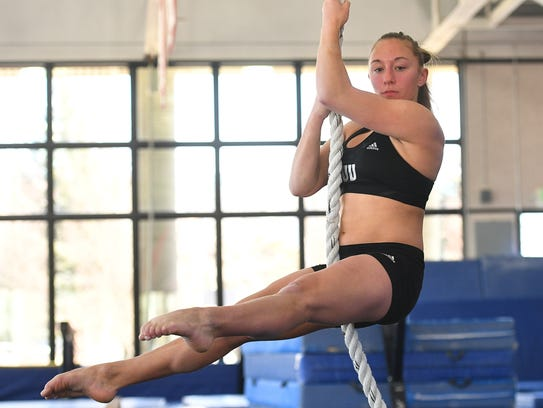 Southern Utah University sophomore Megan McBride climbs