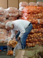 Long-time volunteer Jeff Haas packs carats into a bag