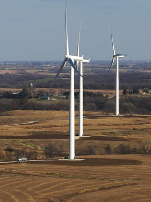 Turbines line the Madison County countryside at the Macksburg wind project turbine farm in rural Macksburg. Iowa ranked third nationally for the most wind energy capacity added in 2014.