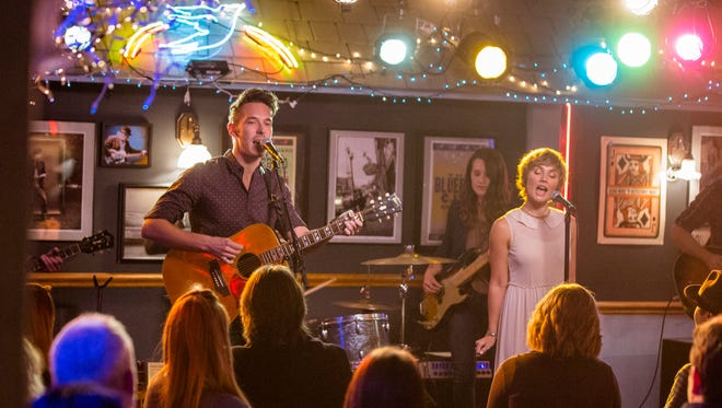 """Sam Palladio and Clare Bowen in a scene from CMT's """"Nashville"""""""