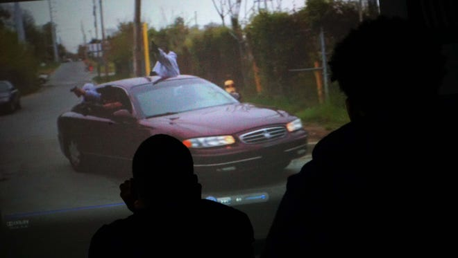 Students at Dickinson High School watch a 15-minute film about joining gangs and the outcomes of getting shot during a Christiana Care program teaching the impact of gun violence.