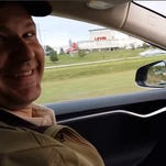 Joshua Brown of Canton, Ohio, in the driver's seat of his Tesla Model S with no hands on the steering wheel while he demonstrates the car's self-driving mode. Brown was killed May 7, 2016, in Williston, Fla., when his car hit a tractor-trailer while it was on the Autopilot system.