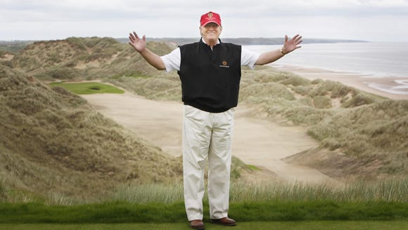 Donald Trump views developments to his luxury golf