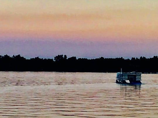 The aquatic day on Lake Lansing ends with a pontoon fleet of homeowners motoring out and about to see stunning sunsets and sip chardonnay.