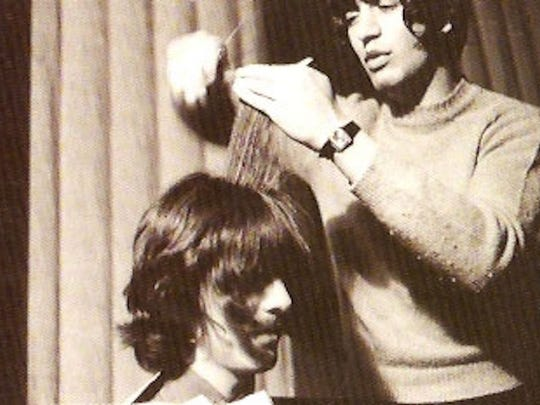 Leslie Cavendish cuts George Harrison's hair.