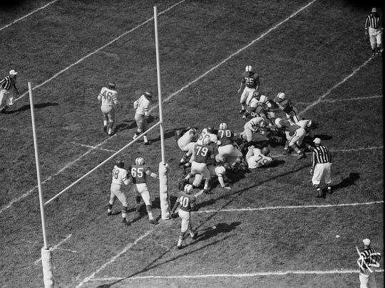 The Baltimore Colts played the Philadelphia Eagles at the newly opened Kentucky State Fairgrounds in Louisville. By Al Blunk, The Courier-Journal.  Sept. 9 1956