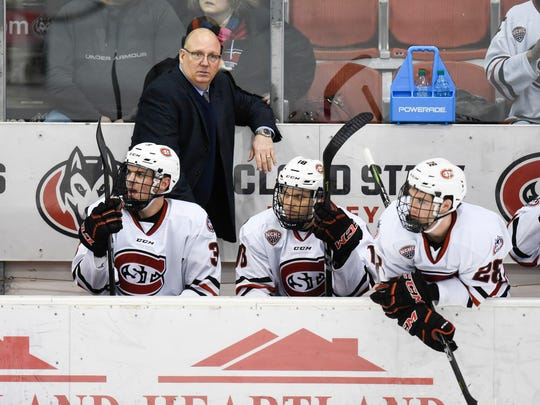 St. Cloud State head coach Bob Motzko watches from the bench during the first period of the Sunday, March 11, game at the Herb Brooks National Hockey Center in St. Cloud.