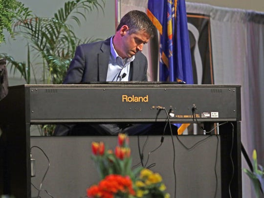 Inspirational speaker John O'Leary plays his mother's favorite song on the piano for nearly 1,700 people at the Professional Dairy Producers of Wisconsin Conference in Madison on March 14. O'Leary has no fingers after nearly dying from an explosion when he was playing with gas at the age of 9.