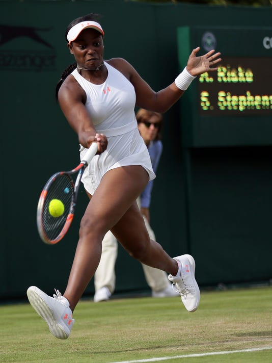 Sloane Stephens of the United States returns to Alison Riske of the United States during their Women's Singles Match on day two at the Wimbledon Tennis Championships in London Tuesday, July 4, 2017. (AP Photo/Tim Ireland)
