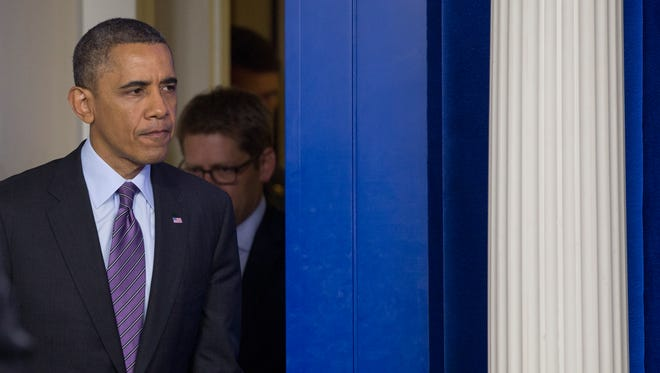 President Barack Obama arrives in the briefing room of the White House on Dec. 5 to speak about the death of Nelson Mandela.