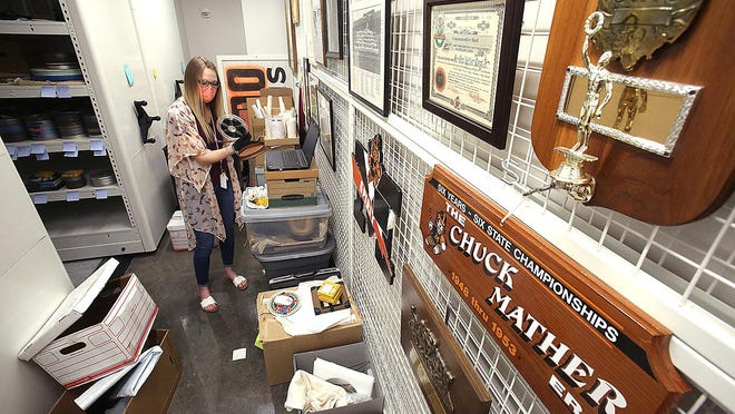 Bailey Yoder, curator of Football Heritage for the Paul Brown Museum at the Massillon Museum, catalogs Massillon vs. Barberton game film from 1950 through 1954 on Thursday, as the museum readies for its Friday reopening.