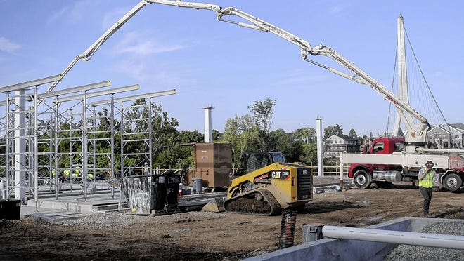 Construction continues Aug. 6 on the east plaza of Dublin's Riverside Crossing Park.