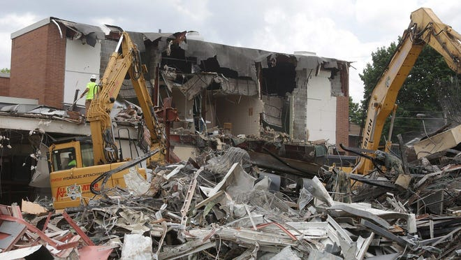 Demolition has begun on portions of the former Washington High School on Oak Avenue to make way for the district's operations facility, which will house the bus garage, mechanic, maintenance and IT departments.