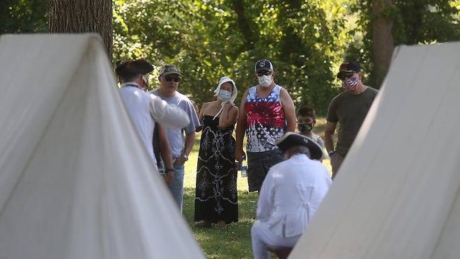 Visitors to the Revolution on the Tuscarawas: Revolutionary War Encampment and Reenactment enjoy the history Saturday. The event will conclude Sunday.