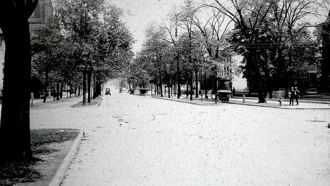 A 1900 photo looking east down East Broad Street from Fourth Street shows the rows of trees that once lined the thoroughfare.